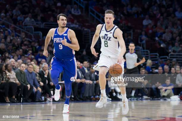 Jonas Jerebko of the Utah Jazz drives to the basket against Dario Saric of the Philadelphia 76ers at the Wells Fargo Center on November 20 2017 in...