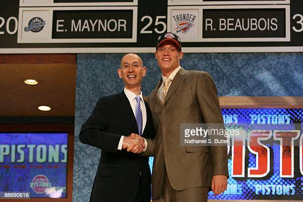 Jonas Jerebko shakes hands with NBA Deputy Commissioner Adam Silver after being selected thirty ninth by the Detroit Pistons during the 2009 NBA...