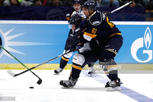 Jonas Johansson of Espoo Blues fights for the puck during the IIHF Champions Hockey League match between HV 71 Joenkoeping and Espoo Blues on...