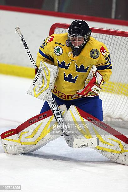 Jonas Johansson of team Sweden takes a shot to the mask during the U-18 Four Nations Cup game against team Finland late on November 7, 2012 at the...