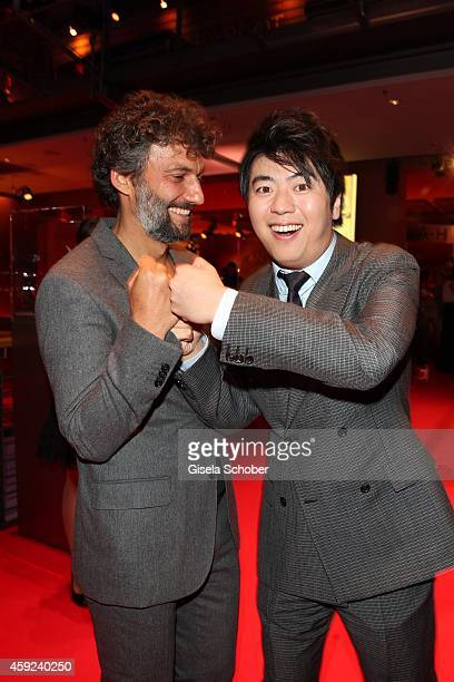Jonas Kaufmann and pianist Lang Lang arrive at the Bambi Awards 2014 on November 13, 2014 in Berlin, Germany.