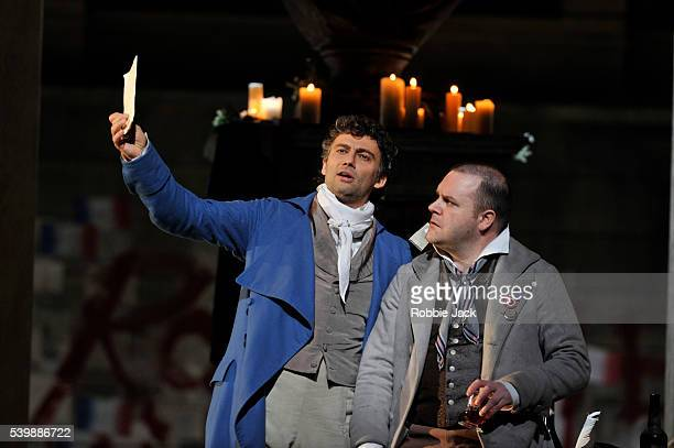 Jonas Kaufmann as Andrea Chenier and Roland Wood as Roucher in the Royal Opera's production of Umberto Giordano's Andrea Chenier directed by David...