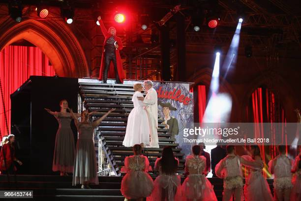 Jonas Kaufmann performs for Conchita Wurst and Herbert Foettinger on stage during the Life Ball 2018 show at City Hall on June 2 2018 in Vienna...