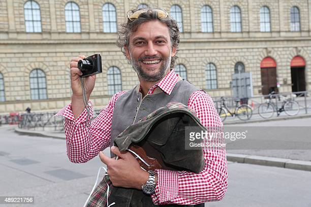 Jonas Kaufmann photographs during the 'Fruehstueck bei Tiffany' at Tiffany Store ahead of the Oktoberfest 2015 on September 19, 2015 in Munich,...