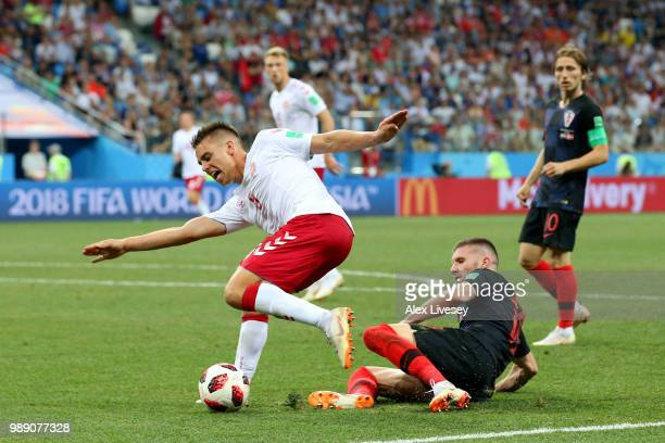 Jonas Knudsen of Denmark and Ante Rebic of Croatia battle for the ball during the 2018 FIFA World Cup Russia Round of 16 match between Croatia and...
