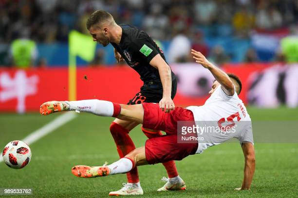 Jonas Knudsen of Denmark and Ante Rebic of Croatia fight for the ball during the 2018 FIFA World Cup Round of 16 match between Croatia and Denmark at...