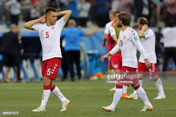 Jonas Knudsen of Denmark and Lasse Schone of Denmark look dejected following their sides defeat in the 2018 FIFA World Cup Russia Round of 16 match...
