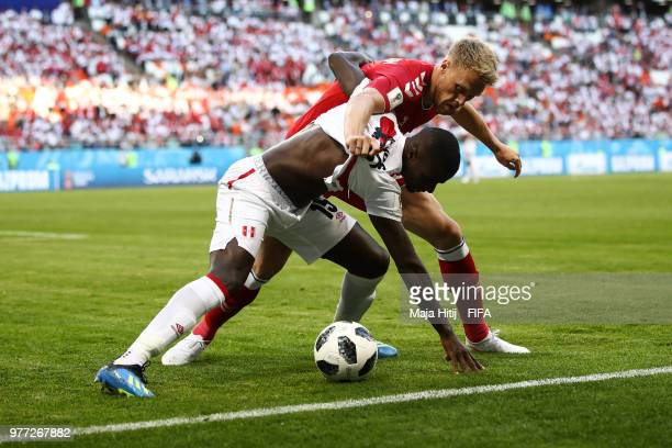 Jonas Knudsen of Denmark is tackled by Christian Ramos of Peru during the 2018 FIFA World Cup Russia group C match between Peru and Denmark at...
