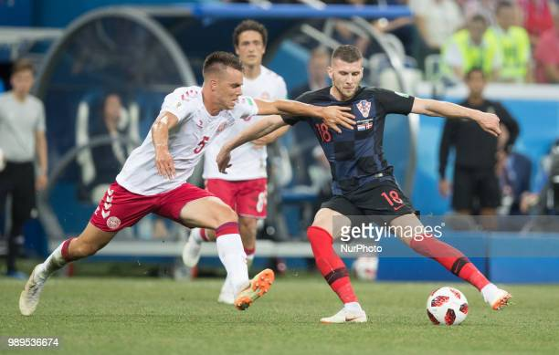 Jonas Knudsen of Denmark vies Ante Rebic of Croatia during the 2018 FIFA World Cup Russia Round of 16 match between Croatia and Denmark at Nizhny...