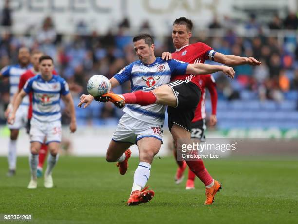 Jonas Knudsen of Ipswich steels the ball from Yann Kermorgant of Reading during the Sky Bet Championship match between Reading and Ipswich Town at...