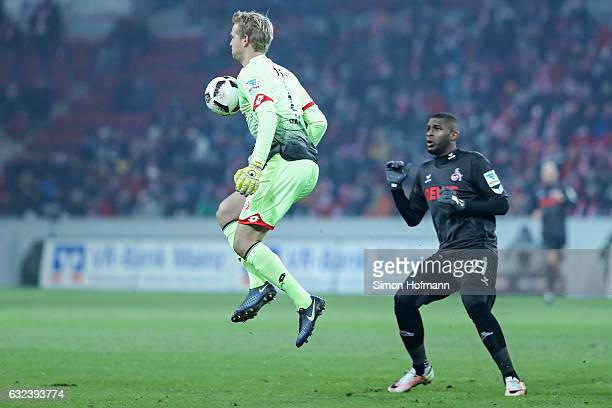 Jonas Loessl of Mainz is challenged by Anthony Modeste of Koeln during the Bundesliga match between 1 FSV Mainz 05 and 1 FC Koeln at Opel Arena on...