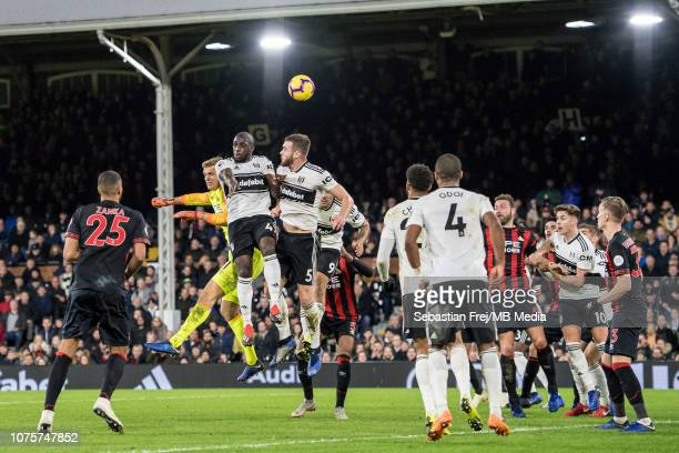 Jonas Lossl of Huddersfield Town and Denis Odoi Calum Chambers and Aboubakar Kamara of Fulham FC jump for ball during the Premier League match...
