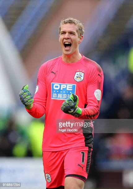 Jonas Lossl of Huddersfield Town celebrates after his sides third goal during the Premier League match between Huddersfield Town and AFC Bournemouth...