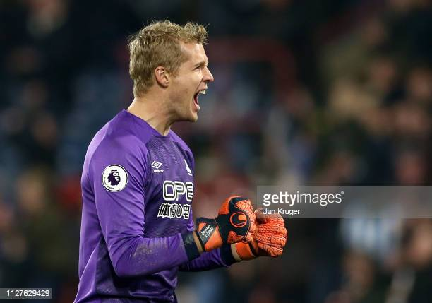 Jonas Lossl of Huddersfield Town celebrates as Steve Mounie scores his team's first goal during the Premier League match between Huddersfield Town...