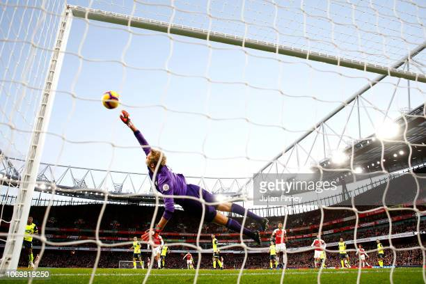 Jonas Lossl of Huddersfield Town dives to make a save during the Premier League match between Arsenal FC and Huddersfield Town at Emirates Stadium on...