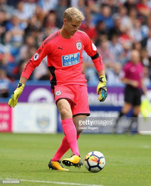 Jonas Lossl of Huddersfield Town passes the ball during the Premier League match between Huddersfield Town and Newcastle United at John Smith's...