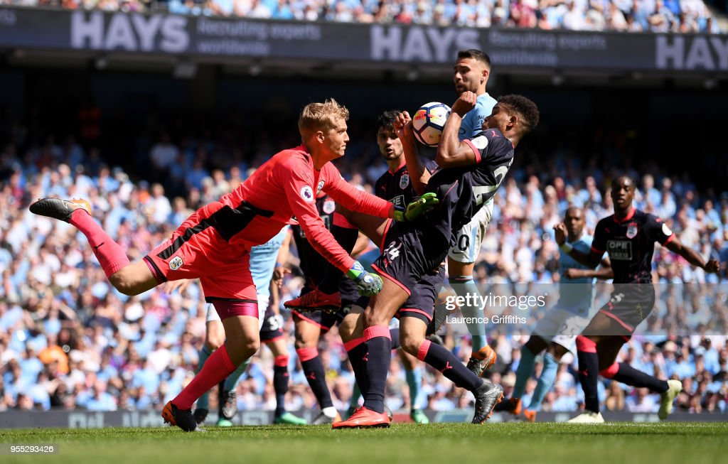 Jonas Lossl of Huddersfield Town punches the ball clear during the Premier League match between Manchester City and Huddersfield Town at Etihad Stadium on May 6, 2018 in Manchester, England.
