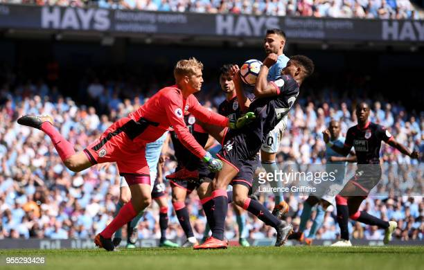 Jonas Lossl of Huddersfield Town punches the ball clear during the Premier League match between Manchester City and Huddersfield Town at Etihad...