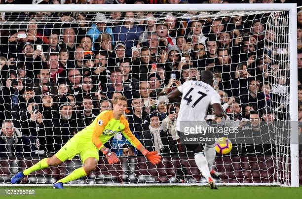 Jonas Lossl of Huddersfield Town saves a penalty from Aboubakar Kamara of Fulham during the Premier League match between Fulham FC and Huddersfield...