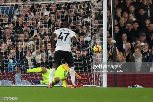 Jonas Lossl of Huddersfield Town saves the penalty of Aboubakar Kamara of Fulham during the Premier League match between Fulham FC and Huddersfield...