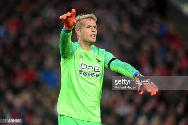 Jonas Lossl of Huddersfield Town signals during the Premier League match between Liverpool FC and Huddersfield Town at Anfield on April 26, 2019 in...