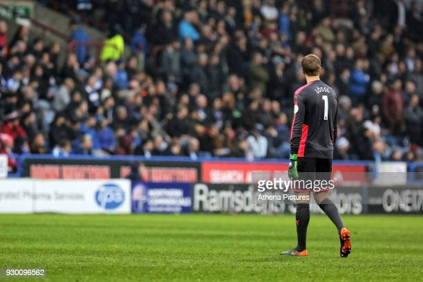 Jonas Lossl spends most of his time watching the game played on the opposite side during the Premier League match between Huddersfield Town and...