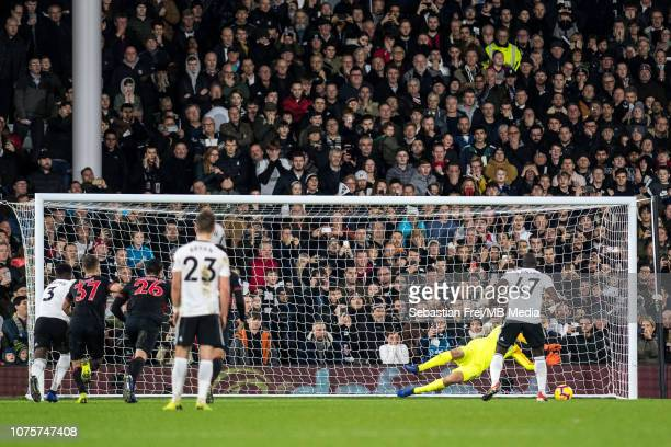Jonas Lössl of Huddersfield Town saves penalty kick taken by Aboubakar Kamara of Fulham FC during the Premier League match between Fulham FC and...