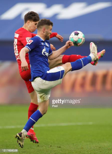 Jonas Michelbrink of Hertha BSC battles for possession with Shkodran Mustafi of FC Schalke 04 during the Bundesliga match between FC Schalke 04 and...