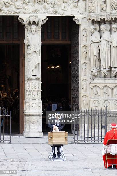 Jonas Moses Lustiger great grandcousin of French Cardinal JeanMarie Lustiger throws soil from the Holy Land on the coffin containing the body of...