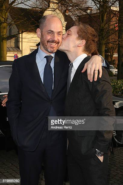 Jonas Nay kisses Edward Berger upon their arrival at the 52th Grimme Award on April 8 2016 in Marl Germany