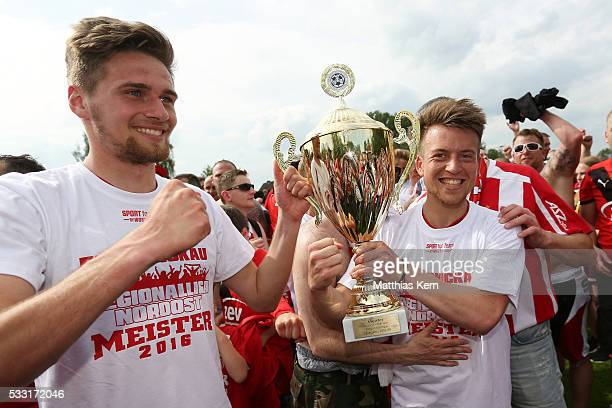 Jonas Nietfeld and team mate Patrick Goebel of Zwickau pose with the trophy after winning the Regionalliga Nordost championship title after the...