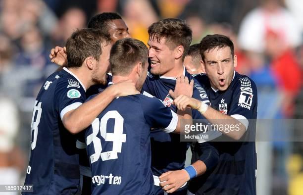 Jonas Nietfeld celebrates with team-mates after scoring his team's first goal of Erfurt during the Third League match between Jahn Regensburg and...