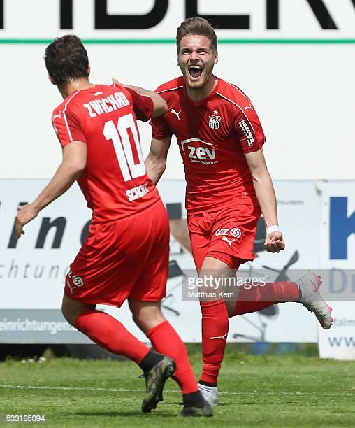 Jonas Nietfeld of Zwickau jubilates with team mate Michael Schlicht after scoring his teams first goal during the Regionalliga Nordost match between...