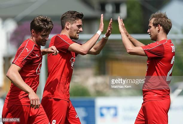 Jonas Nietfeld of Zwickau jubilates with team mates after scoring his teams first goal during the Regionalliga Nordost match between FC Schoenberg 95...