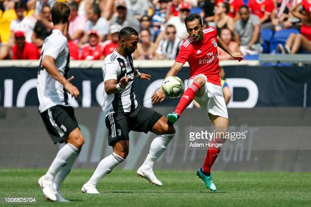 Jonas of Benfica battles for the ball with Emre Can of Juventus during the International Champions Cup 2018 match between Benfica and Juventus at Red...