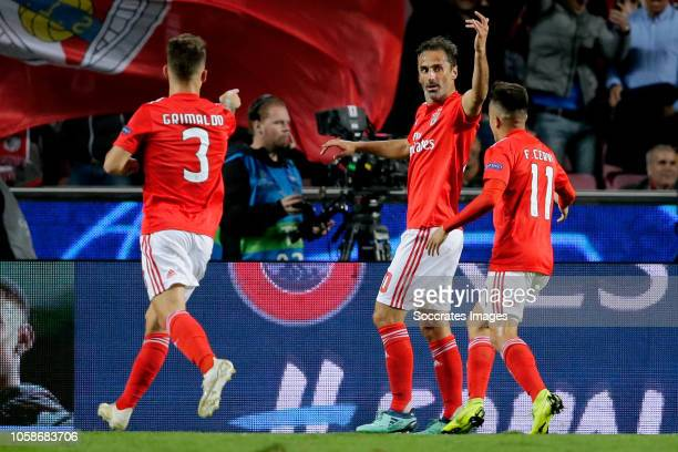 Jonas of Benfica celebrates 10 with Alex Grimaldo of Benfica Franco Cervi of Benfica during the UEFA Champions League match between Benfica v Ajax at...