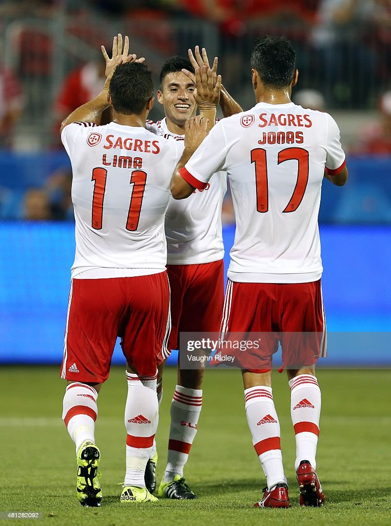 Jonas #17 of Benfica celebrates a goal with Lima #11 and Nico Gaitan #10 during the 2015 International Champions Cup match against Paris Saint-Germain at BMO Field on July 18, 2015 in Toronto, Ontario, Canada.