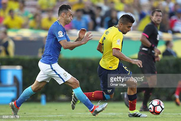 Jonas of Brazil chases Christian Noboa of Ecuador as driving the ball during a group B match between Brazil and Ecuador at Rose Bowl as part of Copa...