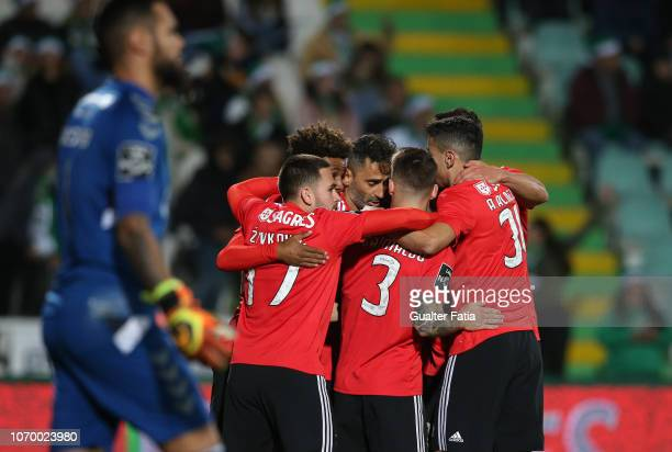 Jonas of SL Benfica celebrates with teammates after scoring a goal during the Liga NOS match between Vitoria FC and SL Benfica at Estadio do Bonfim...