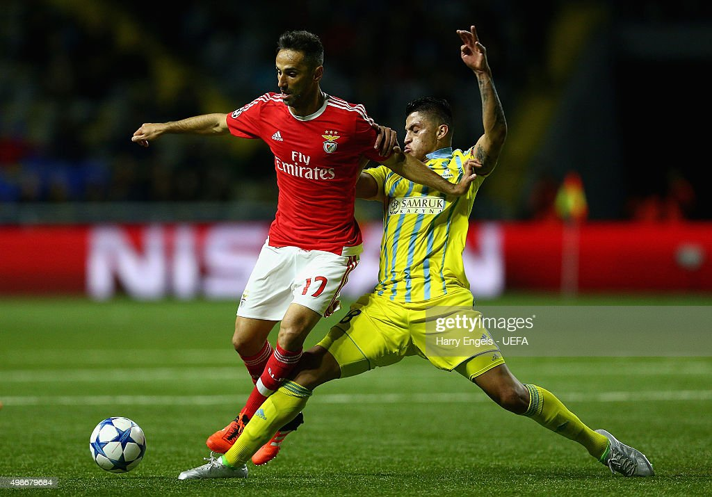 Jonas of SL Benfica (L) is tackled by Roger Canas of FC Astana during the UEFA Champions League match between FC Astana and SL Benfica at the Astana Arena on November 25, 2015 in Astana, Kazakhstan.