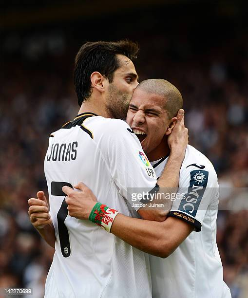 Jonas of Valencia celebrates scoring his sides opening goal with his teammate Sofiane Feghouli during the la Liga match between Valencia CF and...