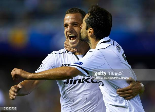 Jonas of Valencia celebrates scoring with his teammate Roberto Soldado during the UEFA Champions League group F match between Valencia CF and LOSC...