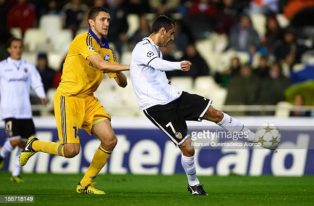 Jonas of Valencia shoots to score the first goal in front of Artem Radkov of BATE Borisov during the UEFA Champions League group F match between...