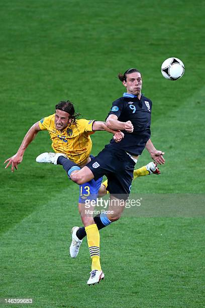 Jonas Olsson of Sweden and Andy Carroll of England compete for the ball during the UEFA EURO 2012 group D match between Sweden and England at The...