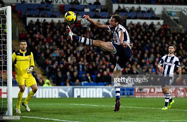 Jonas Olsson of West Brom attempts to keep the ball in play during the Premier League match between Cardiff City and West Bromwich Albion at Cardiff...