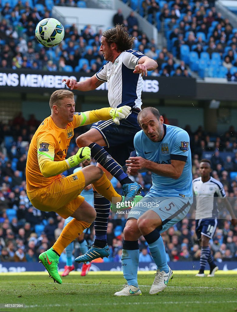 Jonas Olsson of West Brom collides with Joe Hart and Pablo Zabaleta of Manchester City during the Barclays Premier League match between Manchester City and West Bromwich Albion at Etihad Stadium on March 21, 2015 in Manchester, England.