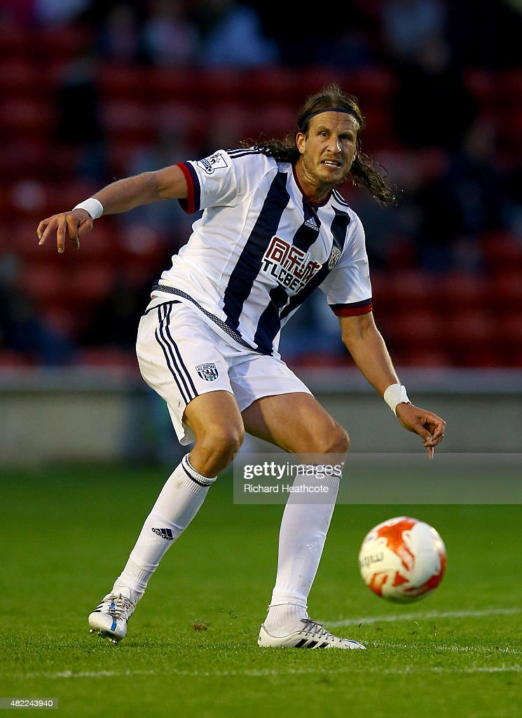 Jonas Olsson of West Brom in action during the Pre-Season Friendly between Walsall and West Bromwich Albion at Banks' Stadium on July 28, 2015 in Walsall, England.