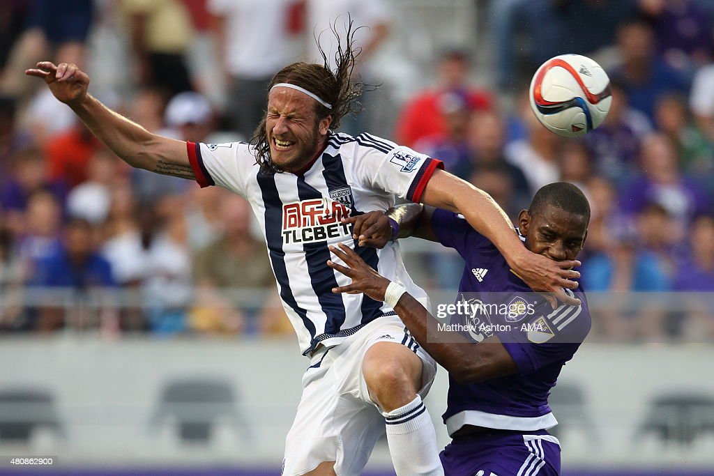 Jonas Olsson of West Bromwich Albion and Bryan Rochez of Orlando City go for a header during the pre-season friendly between Orlando City and West Bromwich Albion at Orlando Citrus Bowl on July 15, 2015 in Orlando, Florida.