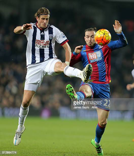 Jonas Olsson of West Bromwich Albion and Jordon Mutch of Crystal Palace during the Barclays Premier League match between West Bromwich Albion and...