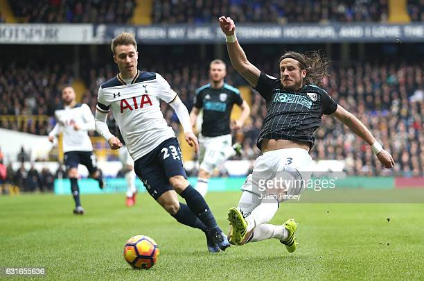 Jonas Olsson of West Bromwich Albion attempts to clear the ball while under pressure from Christian Eriksen of Tottenham Hotspur during the Premier...